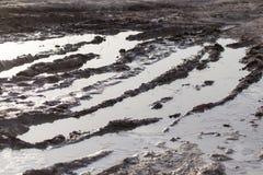 Poça de lama em uma estrada de terra Foto de Stock