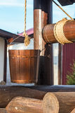 Poço de madeira. Cubeta em uma corda Imagens de Stock Royalty Free