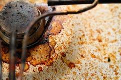 Poêle de gaz modifié avec des souillures de café Photographie stock