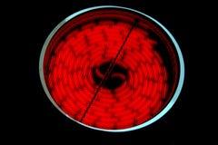 Poêle en céramique d'un rouge ardent Images libres de droits