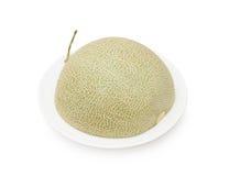 Połówka odizolowywająca na białym tle kantalupa melon zdjęcia royalty free
