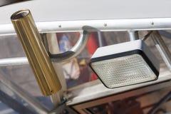 Połowów akcesoria - prącia światło reflektorów i właściciel Zdjęcia Stock
