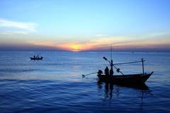 połowu błękitny łódkowaty niebo dwa zdjęcia royalty free