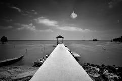 Połowu jetty w czarny i biały przy Portowym Dickson Zdjęcie Stock