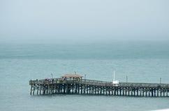 Połowu molo przy mirt plażą Zdjęcie Royalty Free
