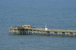 Połowu molo przy mirt plażą Fotografia Stock
