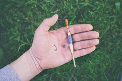 Połowu sprzęt na ręce Fotografia Royalty Free