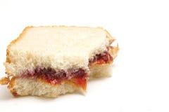 połowy zjedzona kanapkę z dżemem Fotografia Royalty Free