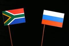 Południe - afrykanin flaga z rosjanin flaga odizolowywającą na czerni Zdjęcie Stock