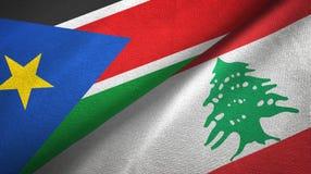 Południowy Sudan i Liban dwa flagi tekstylny płótno, tkaniny tekstura fotografia stock