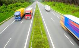 pośpieszne ciężarówki Zdjęcia Stock