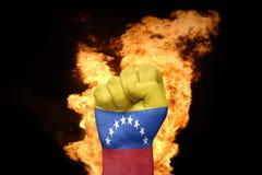 Pożarnicza pięść z flaga państowowa Venezuela Obraz Stock