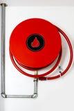 pożarniczego wąż elastyczny ściana Zdjęcia Royalty Free