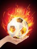Pożarniczej piłki chwyt w ręce Obrazy Royalty Free