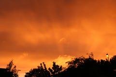 Pożarniczy czerwony nieba słońce ustawiający Zdjęcia Stock