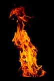 Pożarniczy płomień odizolowywający na czarnym odosobnionym tle - Piękny yel Zdjęcia Royalty Free