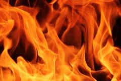 Pożarniczy płomień tekstury tło Zdjęcia Stock