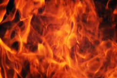 Pożarniczy płomienia tło Zdjęcia Royalty Free