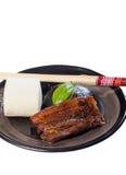 Po ήχων καμπάνας χοιρινό κρέας με το βρασμένο στον ατμό κουλούρι mantou Στοκ Φωτογραφία