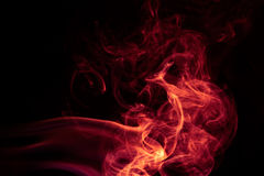 Pożarniczy Czerwony abstrakta dymu projekt na czarnym tle Fotografia Stock