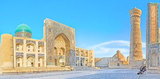 Po-i-Kalan complex. BUKHARA, UZBEKISTAN - APRIL 28, 2015: The architectural complex of Po-i-Kalan consists of Mir-i Arab Madrassah, Kalyan Minaret and Kalyan stock images