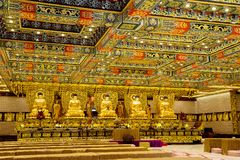 Hong Kong, China, the interior of the Po Lin monastery on Lantau island. Po Lin Monastery was built in 1924. Its name means `Precious Lotus`. The walls are stock images