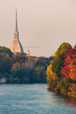 Po river in turin city with mole antonelliana and people walking in part Stock Image
