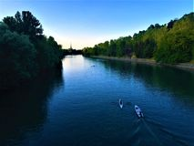 Po River and Valentino Park in Turin city, Italy. Po River and Valentino Park. Beauty, water, enchanting atmosphere, blue sky, nature, light, shining and stock photo