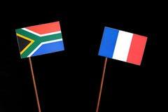 Południe - afrykanin flaga z francuz flaga na czerni Zdjęcia Royalty Free