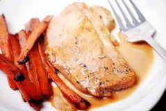 Poached chicken with carrots stock photography
