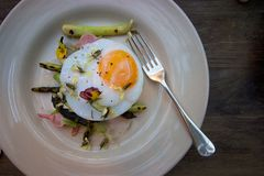 Poached duck egg on asparagus with flowers Stock Images
