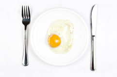 Poached egg. In white plate Royalty Free Stock Photos