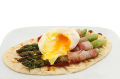 Poached egg and asparagus Stock Image