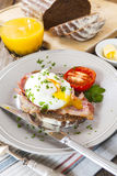 Poached egg and bacon on rye bread, healthy breakfast Stock Images