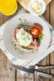 Poached egg and bacon on rye bread, healthy breakfast Stock Photos