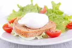Poached egg on bread Stock Photography