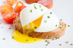 Poached egg on bread Royalty Free Stock Images