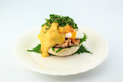 Poached egg on English muffins toasted,tuna, and delicious buttery hollandaise sauce with Shiso Leaf Royalty Free Stock Images
