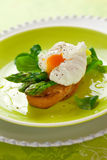 Poached egg and green asparagus Stock Photo