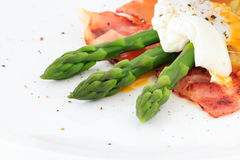 Poached egg on green asparagus Royalty Free Stock Image