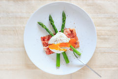 Poached egg on green asparagus Stock Image