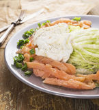 Poached egg with green salad and salmon Stock Photos