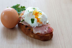 Poached egg and ham on toasted ciabatta Royalty Free Stock Photo