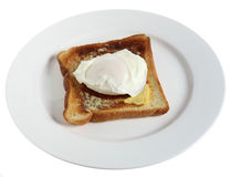 Poached egg on plate over white Stock Photos