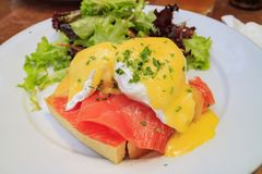 Poached egg with raw salmon. And bread, ate at Los Angeles, California, United States Royalty Free Stock Images
