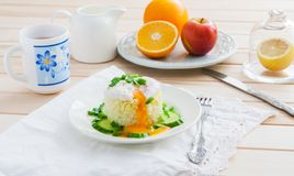 Breakfast on wooden background. Poached egg on rice - breakfast on wooden background Royalty Free Stock Images