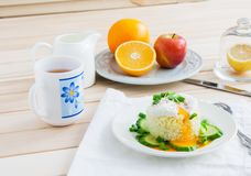 Breakfast on wooden background. Poached egg on rice - breakfast on wooden background Stock Photos