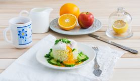 Breakfast on wooden background. Poached egg on rice - breakfast on wooden background Stock Images