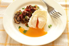 Poached egg with roasted mushrooms Royalty Free Stock Photo