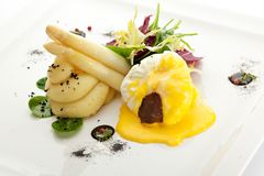 Poached Egg with Salad Mix. Poached Egg with Mashed Potato and Truffel Slice Stock Photography
